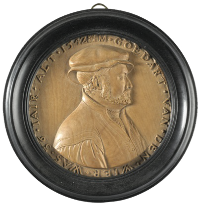 This medallion is a circular, post-medieval, boxwood medallion, the portrait being of Goedart van der Wier, believed to be a Dutch burgher, in profile to the right. The medallion is relatively large, at 2 7/8 in (7.2 cm) compared with the other medallions in the Bequest, but this diameter includes the frame. It is German, carved in Cologne in 1544 by Friedrich Hagenhauer. It is inscribed: M.GOEDART.VAN.DER.WIER WAS. 36 IAIR. ALT. 1542