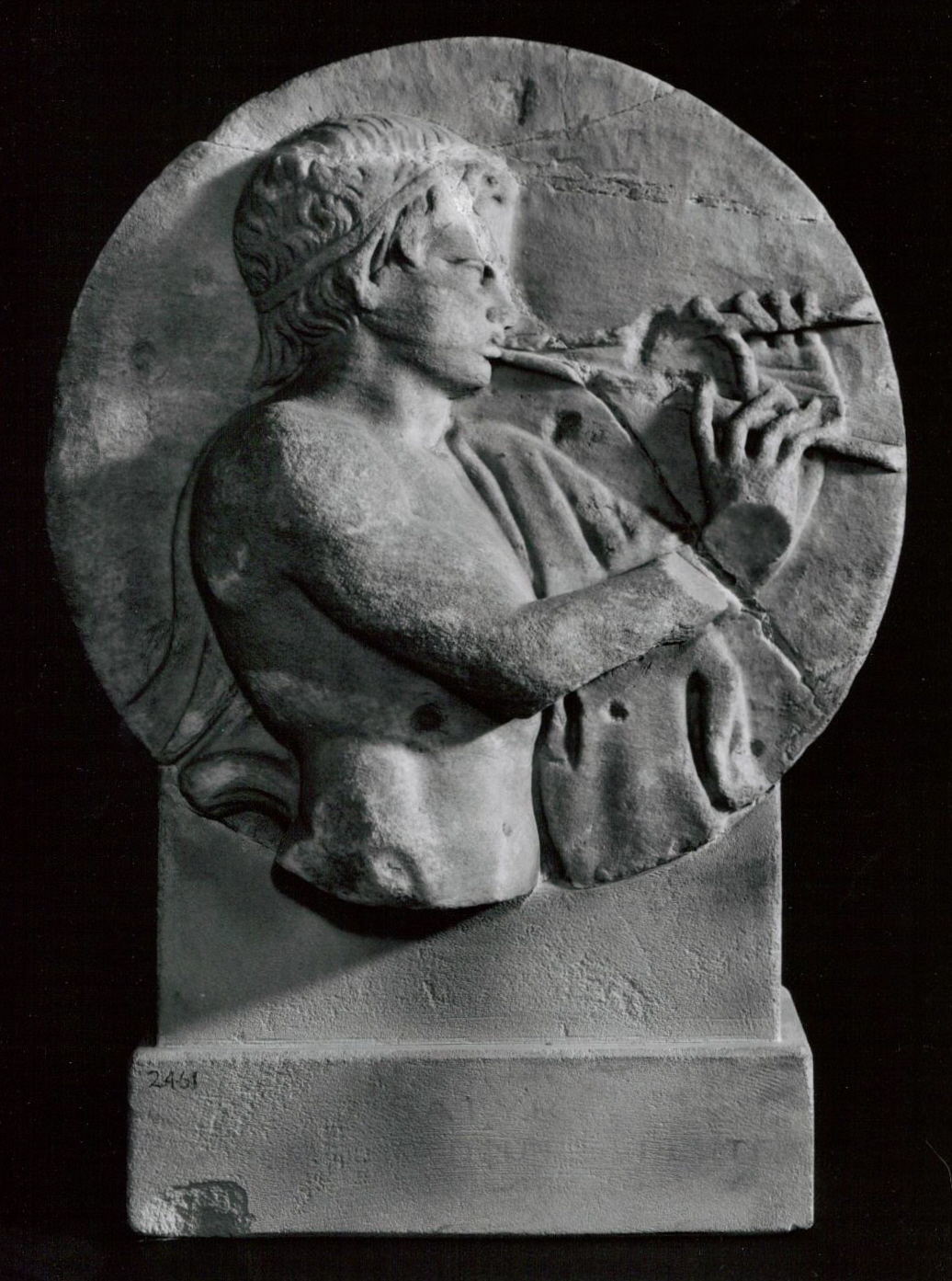 Marble relief from a sarcophagus of a satyr playing vertical double pipes (Roman 2-3rd century) (Photo: Courtesy of the British Museum)