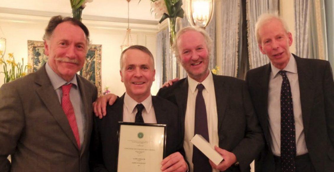 Clinton Lodge head gardener receiving prize