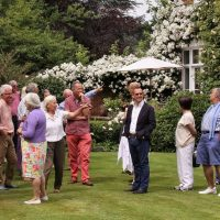 Biddy Marshal talks about the garden whilst EBTS UK members admire it
