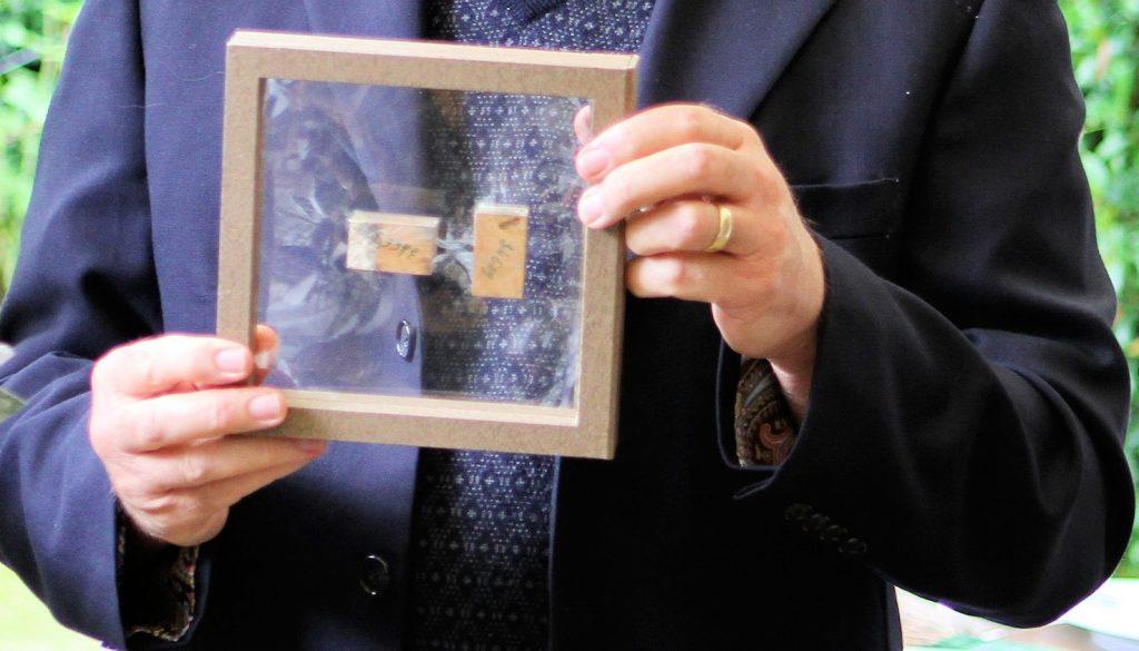 Lynn Batdorf holding two boxwood stamps from Yvert & Tellier HL